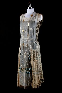 vintage 1920's dress Tan/taupe cotton blend Embroidered floral lace  Sky blue silk ribbon accents Pulls over head - no back or side closure  semi-sheer - shown over black slip
