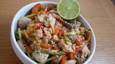 One-pan spiralizer salmon stir fry noodle bowl with courgette, carrot, mushrooms, ginger and garlic