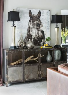 @I.O. Metro sideboard with driftwood, horse painting and silver vases
