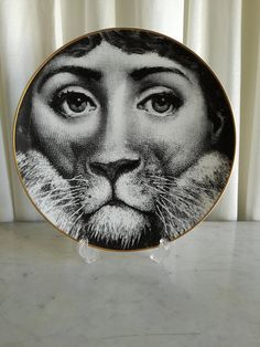 Check out this item in my Etsy shop https://www.etsy.com/listing/601921824/fornasetti-plate-decor-plate-rosenthal