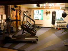 Some men need a fun space to get exercise and stay fit. Check out these photos of manly home gyms to get inspiration for your home.