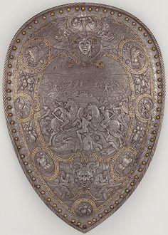 Shield of Henry II of France, France, ca. 1555.  The battle scene at the center is thought to depict the victory of Hannibal and the Carthaginians over the Romans in Cannae in 216 B.C., which here could be interpreted as an allusion to the struggle of France against the Holy Roman Empire during the sixteenth century. In the strapwork borders are the intertwined letters: H for Henry II (reigned 1547–59);