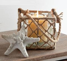 "The K&K Interiors Set of 4 4.5"" Square Rope Basket with Glass #Lantern measures 4.5"" in height x 5"" in width x 5"" in diameter."