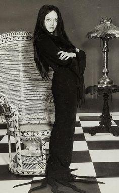 Carolyn Jones as Morticia Addams