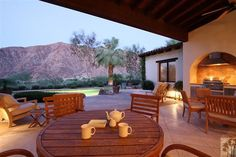 Endless french doors in both great rooms of this stunning home open to the loggia with fireplace and BBQ to entertain Desert Style.  Del Gato Dr, La Quinta, CA