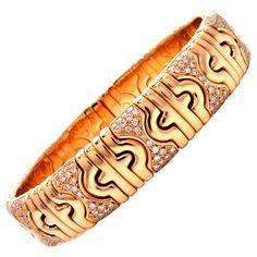 Bulgari Diamond Gold Bangle Cuff Bracelet | From a unique collection of vintage cuff bracelets at https://www.1stdibs.com/jewelry/bracelets/cuff-bracelets/