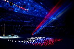 Athlete marshals light up to form a Russian flag during the Opening Ceremony of the Sochi 2014 Winter Olympics at Fisht Olympic Stadium on F...