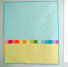 i love quilt backs that are pieced together.  they're just so pretty! and the scrappy bindings? My heart just skips a beat.