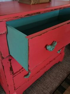 My sweet coral.  I loved doing this dresser in general finishes milk paint and top coat.  Love the contrast of the green.  www.facebook.com/2nddoorontheright