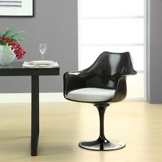 Odyssey Arm Chair - Suitable for lounging or dining, they feature foam pads to protect hard flooring surfaces. Available in black or white, with different colored cushions. $289