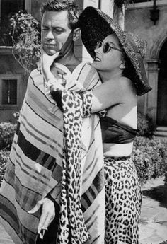 """Gloria Swanson and William Holden relaxing on the set of """"SUNSET BOULEVARD"""" (1950) at Paramount film studios."""