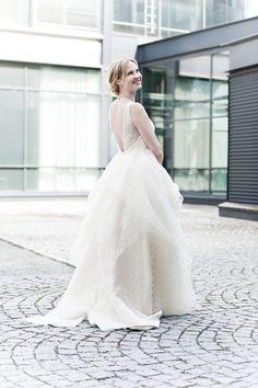 Real wedding in Finland. Dress made by Pukuni (www.pukuni.fi). Lace wedding dress, open back.