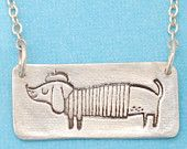 L'ARTISTE WIENER DOG necklace, illustrated by Gemma Correll, eco-friendly silver.  Handcrafted by Chocolate and Steel