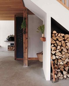 The concrete floors throughout the house look seamless, so they flow as one space. The ceiling is pine from a local lumberyard—which the couple planed and milled. Old Fireplace, Fireplaces, Gravity Home, Home Ceiling, Old Farm Houses, Dining Nook, Barn Lighting, Blog Deco, Nature Decor