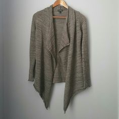 Express metallic asymmetric cardigan Gently worn -- excellent condition!!  Bundle for best deals!! Lots of items available starting at $5! Hundreds of items available for discounted bundles! You can get lots of items for a low price and one shipping fee! Express Sweaters Cardigans