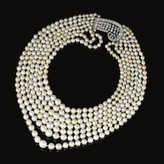 Natural pearl and diamond necklace, one cultured