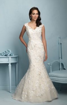 Allure Bridals 9220 is a fit and flair gown with floral appliqués. The thick straps allow for support. The back of this dress is low and breath taking.  Show off your figure in Allure Bridals 9220.