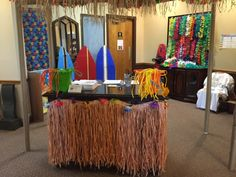 Close up scene of the Welcome Center! Love the way it is organized and ready for new Surfers. Love the pops of color and surfboards along with each related fun and focus! cokesburyvbs.com