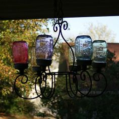 Mason Jar DIY Chandelier Super strong glue, and tinting the jars.