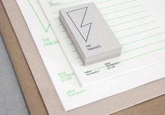 Logo and uncoated, unbleached stationery with fluorescent green ink print finish for The Fableists designed by Freytag Anderson.