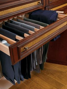 Having a spot for every item is key to creating a well-organized closet. Suit pants, for instance, are always the bane of a guy's existence. Fold and hang them wrong, and you'll get awkward, messy creases up and down the pant legs. Hang them properly, and they'll stay neatly pressed. This hideaway pullout for suit pants keeps each pair just far enough apart for them to stay immaculately folded.
