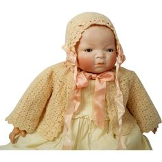 """Very special 18"""" w/ 15"""" HC, early 1920s Bisque Brown-Eyed Bye-Lo Signed, Head Swivels, Lots of Extras, 13- piece Layette."""