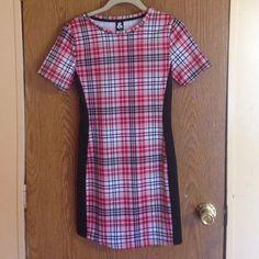 SALE  Cute Plaid Mini-Dress Plaid mini dress. Colors: Black, Red, and White. NWOT. Never worn. Dresses Mini