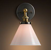 Here's your mixed metals:   Restoration Hardware Glass Funnel Filament Sconce Aged Steel