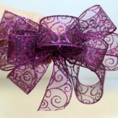 Make any gift extra special by making your own bow for it. Watch this video and learn how simple it is to make Wire-Edged Ribbon Bows.