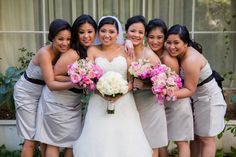Bridesmaids bouquets in pink roses and sweetpeas