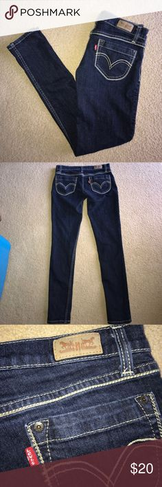 """Levi's Dark Skinny Jeans These are a size 27 (US 4 R) pair of dark wash skinny jeans by Levi's! They're practically brand new and have absolutely no rips, stains, or tears! The inseam is 32"""". Levi's Jeans Skinny"""