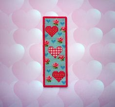 Made by Marian. Bookmark with hearts embroidered on plastic canvas. A 'Vervaco' cross stitch Bookmark kit.