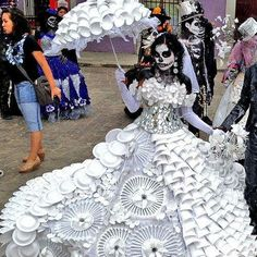 Awesome Day of the Dead dress.  I think I read that it was made entirely out of paper plates.  That takes some commitment.
