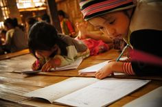 Children practising writing at the school in the refugee camp