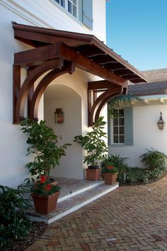 Wooden Awning (British West Indies style by Village Architects)/idea for how to frame awning over sliding door but paint white and use galvanized roofing panels