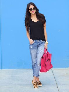 Comfy boyfriend jeans and a loose-fitting tee is basically our go-to outfit this spring. Rachel Parcell of Pink Peonies blog gives her low-key look a fun pop with leopard kicks and a neon bag.   - Seventeen.com