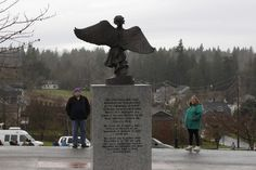 Chuck, left, and Judy Cox, right, view a newly installed memorial to people who have suffered the loss of a child, Monday Dec. 3, 2012, at Woodbine Cemetery in Puyallup, Wash. The memorial is near where their grandsons, Charlie and Braden Powell, were buried after their father, Josh Powell, killed them and himself earlier in 2012 during an investigation into the disappearance of Josh's wife, Susan. (AP Photo/Ted S. Warren)