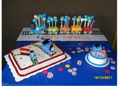 Thomas the Train cakes.. I could do cake pops in the back train for Thomas's 3rd bday. :) with the larger cake too..