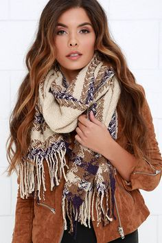Let the good times roll without thinking about the chill in the air with the And So It Flows Beige Print Scarf!