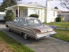 1960 Mercury Comet. I've always had an affinity for cars with tail fins. But I especially love these. They look like cats eyes.