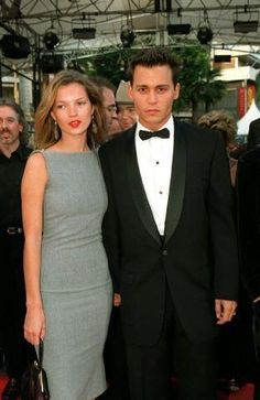 One of the best Kate Moss moments.  Flowing hair, red lips, and fitted dress that looks both classic, fresh and young
