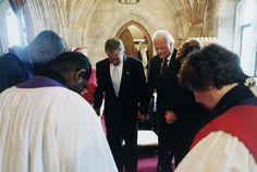 Billy Graham prays with other leaders at the Washington National Cathedral after 9/11.