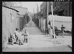 Children playing in De Frees Alley, N.E. Washington, D.C., near Capitol building. One basement room rents for nine dollars a month; two rooms upstairs for sixteen dollars;  one bath and cold water in the hall for entire building