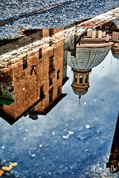 Reflection of the church Basilica Mauriziana in via Milano. Rain, rain, rain left puddles of water on the ground, and they are perfect for making photos of reflection of the urrounding buildings such ...