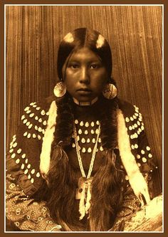 This photograph is by Edward S. Curtis but  is just titled: Indian Girl. I doubt very much whether that is the original Curtis title. A beautiful photograph though the title does not do it justice.
