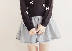 I really like this outfit of the black sweater with the white beading and the light washed blue skirt.