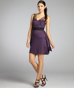 188.99 Vera Wang Lavender Label  aubergine cotton jewel belted ruffle and mesh tank dress Lightweight cotton V-neckline; spaghetti straps feature sheer mesh tank overlay Two tiers at natural waist Jewel encrusted grosgrain tie belt