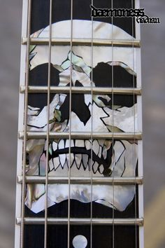 Daemoness Guitars skull inlay.