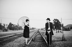 Charlie Chaplin themed engagement photos... what a fun Idea! I think the man may be wearing too much eye makeup.. but other than that.. I love it! :)