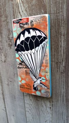 Parachuting Humming Bird Graffiti Painting on by thefactory101